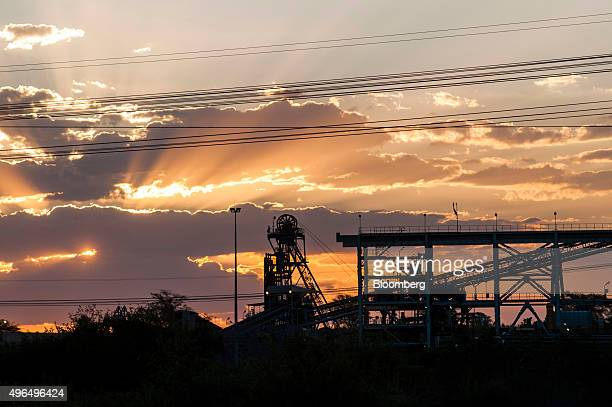 The sun sets over the Marikana platinum mine operated by Lonmin Plc in Marikana South Africa on Monday Nov 9 2015 Lonmin's warning that it may be...