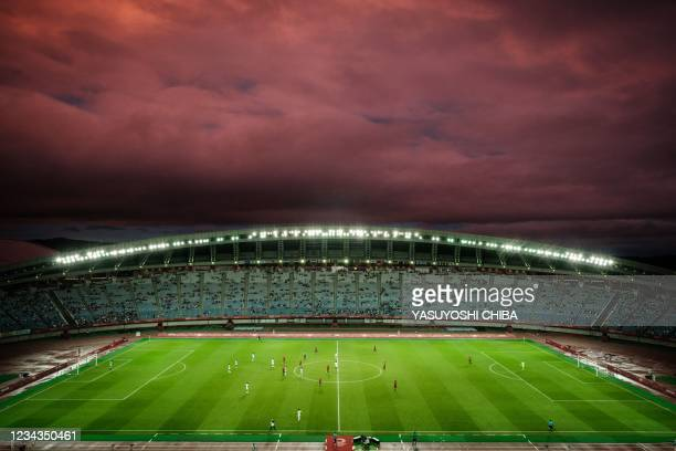 The sun sets over the Miyagi Stadium during the Tokyo 2020 Olympic Games men's quarter-final football match between Spain and Ivory Coast in Miyagi...