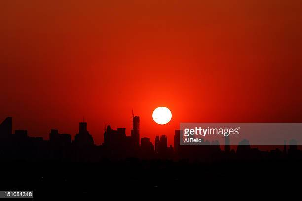 The sun sets over the New York city skyline seen from the Arthur Ashe Stadium during the men's singles second round match between Andy Roddick of the...