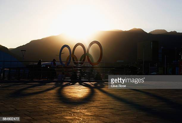 The sun sets over the Olympic rings ahead of the 2016 Summer Olympic Games on July 31 2016 in Rio de Janeiro Brazil