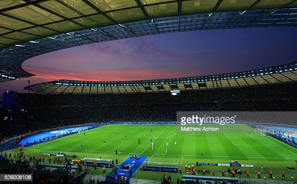 The sun sets over the Olympic stadium in Berlin