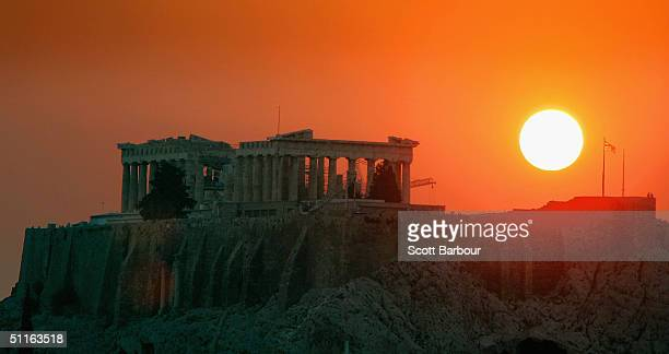 The sun sets over the Parthenon on the eve of the Opening Ceremony of the 2004 Summer Olympic Games August 12 2004 in Athens Greece The 2004 Olympic...