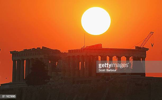 The sun sets over the Parthenon on the eve of the Opening Ceremony August 12, 2004 in Athens, Greece. The 2004 Olympic Games will start on Friday,...