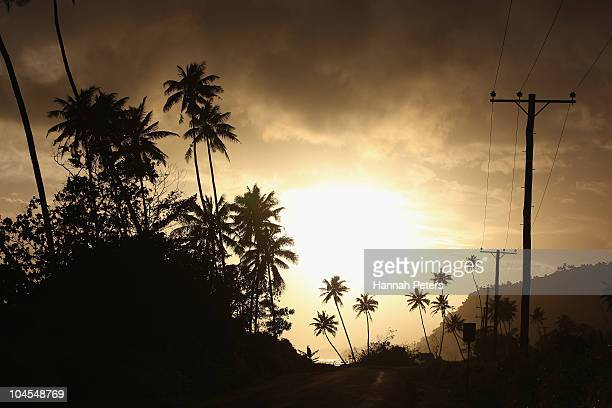 The sun sets over the road to Lalomanu on September 28 2010 in Apia Samoa 189 people were killed and hundreds more injured in Samoa American Samoa...