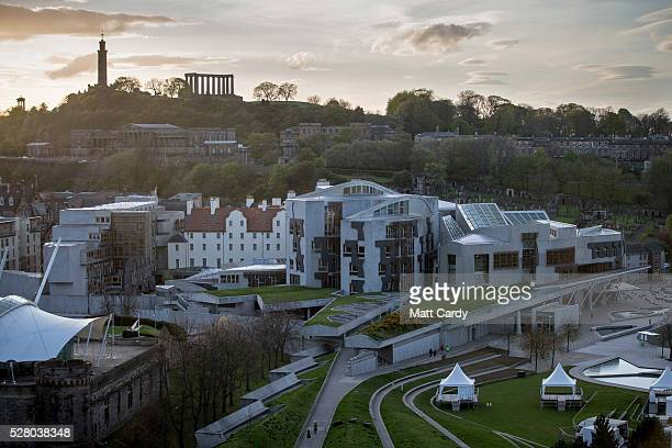 The sun sets over the Scottish Parliament Building on May 3 2016 in Edinburgh Scotland As campaigning for the Holyrood election enters its last...