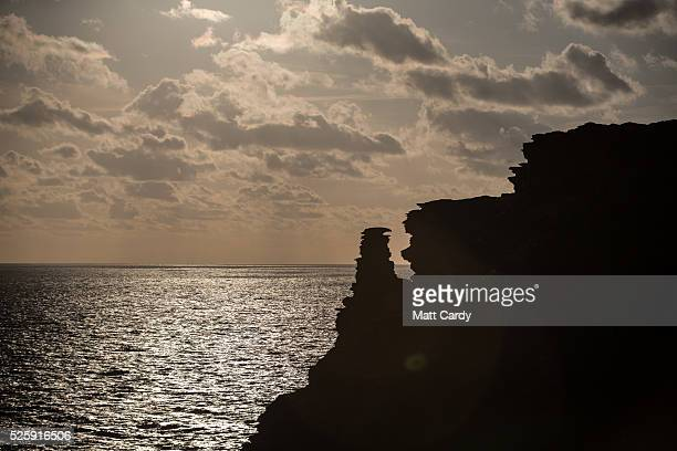 The sun sets over the sea at Tintagel Castle on April 27 2016 in Cornwall England The English Heritage managed site and the nearby town have long...