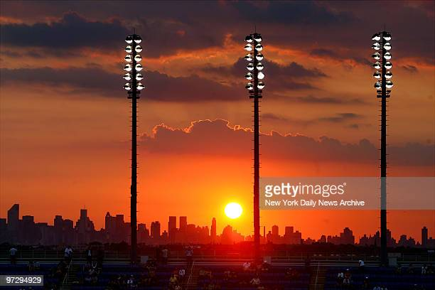 The sun sets over the skyline of Manhattan as seen from Arthur Ashe Stadium at the Billie Jean King National Tennis Center during a 2007 US Open...