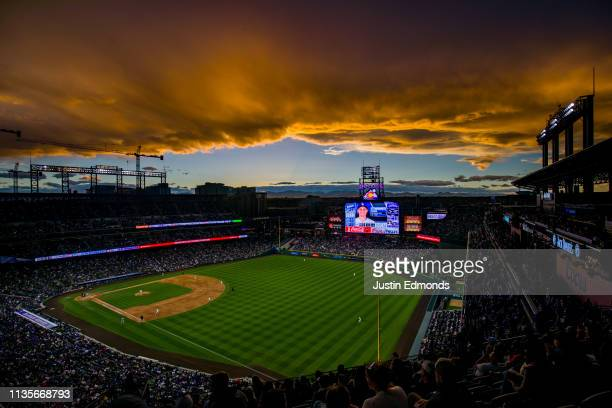 The sun sets over the stadium as the Colorado Rockies take on the Los Angeles Dodgers at Coors Field on April 7 2019 in Denver Colorado