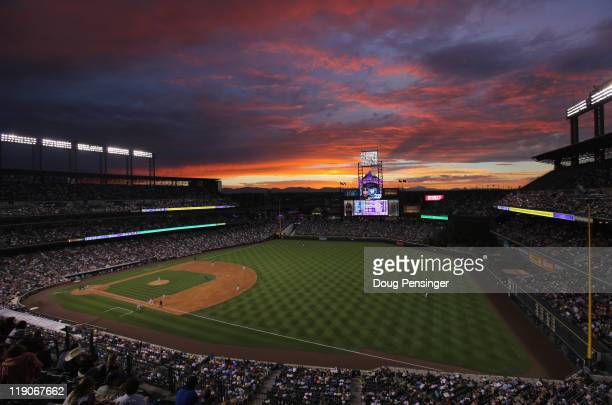 The sun sets over the stadium as the Milwaukee Brewers face the Colorado Rockies at Coors Field on July 14, 2011 in Denver, Colorado.