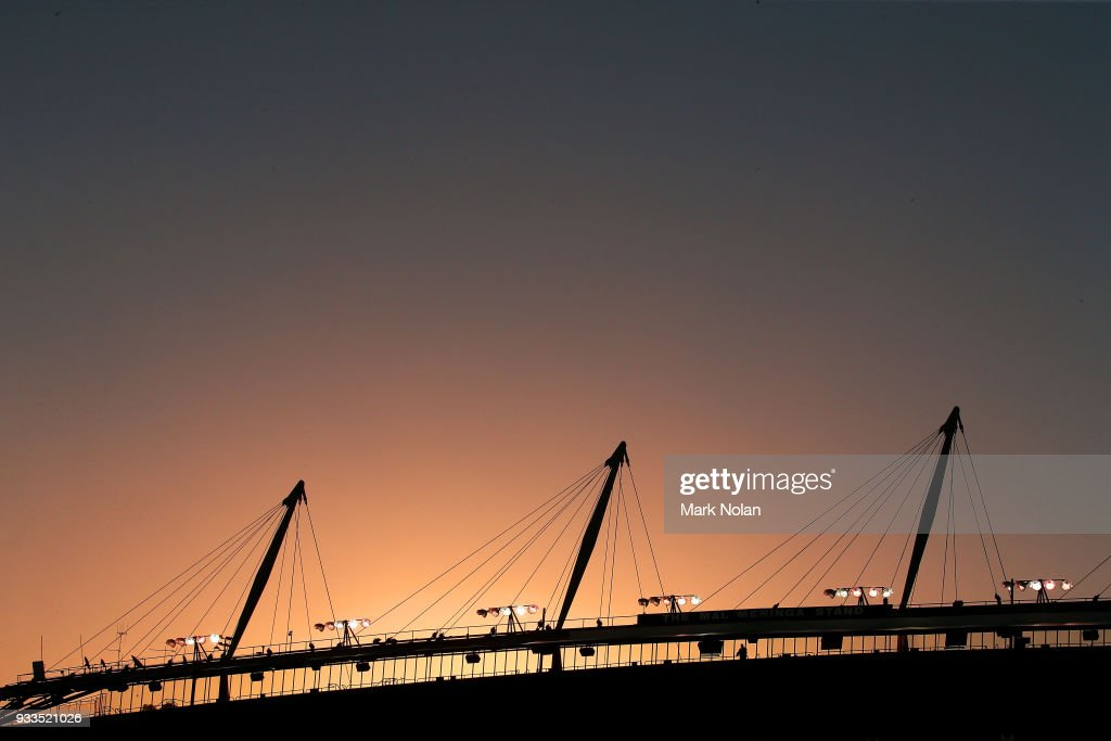 The sun sets over the stadium during the round two NRL match between the Canberra Raiders and the Newcastle Knights at GIO Stadium on March 18, 2018 in Canberra, Australia.