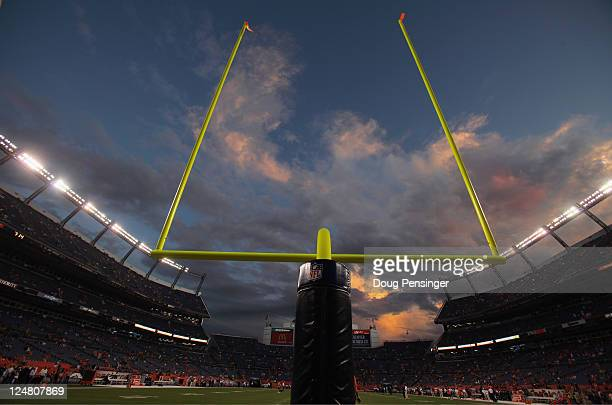 The sun sets over the stadium prior to the game as the Oakland Raiders face the Denver Broncos at Sports Authority Field at Mile High on September 12...