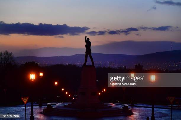 The sun sets over the statue of Lord Carson and Stormont on December 7 2017 in Belfast Northern Ireland There was little sign of any political...