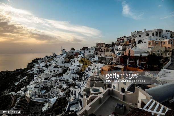The sun sets over the town of Thyra on the northwestern tip of the Greek island of Santorini in the Aegean Sea on May 20 2020 The government on May...