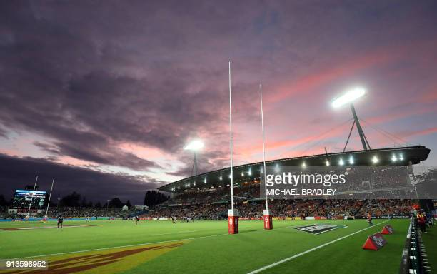The sun sets over Waikato Stadium during the World Rugby Sevens Series match between New Zealand and Argentina in Hamilton on February 3, 2018. / AFP...