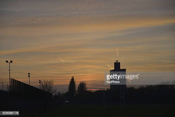 The sun setting over Manchester England UK on Sunday 22nd March 2015