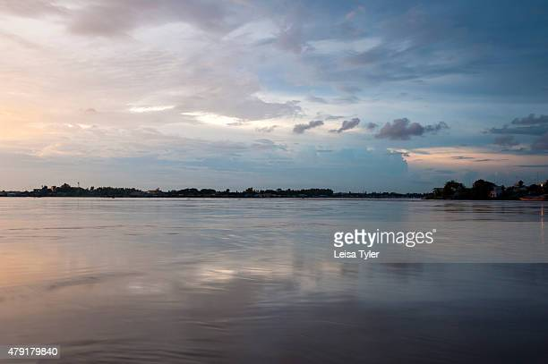 The sun setting over the Bassac River at Chao Doc a town on the Mekong Delta in Vietnam The Mekong has the largest delta of any river in the world