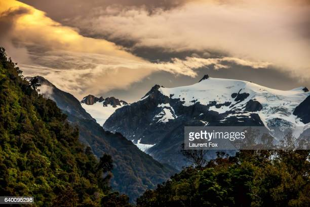 The sun setting over the Franz Josef glacier located on the south island of New Zealand.