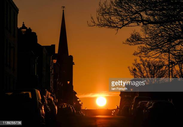 The sun shines down a street in Saltburn as it rises on March 30 2019 in Saltburn By The Sea England