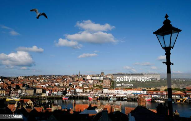 The sun shines down on Whitby as enthusiasts for Goth culture arrive for Whitby Gothic Weekend on April 13, 2019 in Whitby, England. The Whitby Goth...