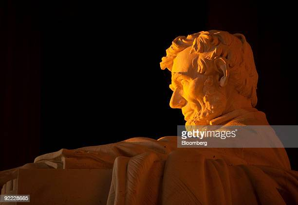 The sun shines on a statue of Abraham Lincoln at the Lincoln Memorial in Washington DC US on Tuesday Oct 20 2009 Washington founded in 1791 is the...