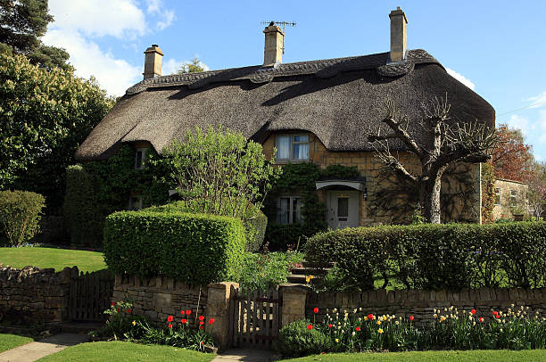 The Sun Shines On A Thatched Cottage In Cotswold Town Of Chipping Campden April