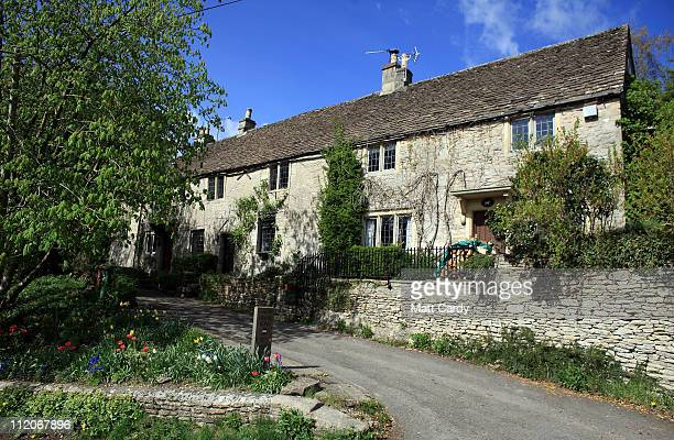 The sun shines on historic buildings in the Cotswold village of Castle Combe on April 12 2011 in Wiltshire England A popular tourist destination the...