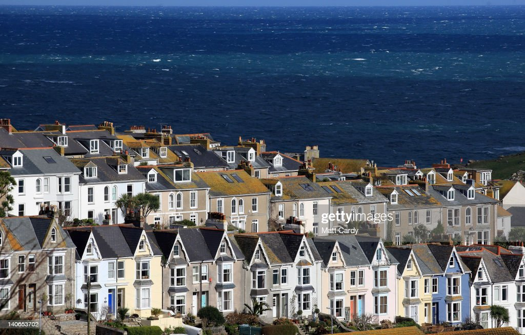 The sun shines on houses and buildings around the harbour of St Ives on March 4, 2012 in Cornwall, England. With only a few months to go until the opening ceremony of the London 2012 Olympic games, Britain's tourist industry is hoping to benefit from the influx of athletes, officials and visitors.