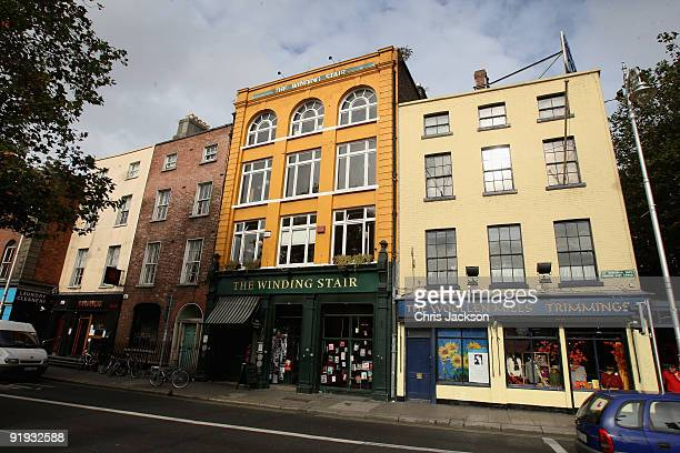 The sun shines on shops with colourful facades next to Ha'penny Bridge on October 15 2009 in Dublin Ireland Dublin is Ireland's capital city located...