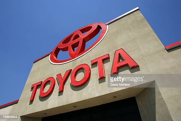 The Sun shines on the Toyota logo at the world's largest auto dealership Longo Toyota which enjoys continued strong sales after a record quarterly...