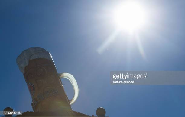 The sun shines onto an oversized beer jug on the top of a tower at the Oktoberfest area in Munich Germany 24 August 2016 The Oktoberfest will take...