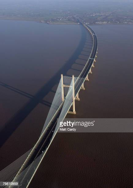 The sun shines over the Severn Estuary and the second Severn Bridge on February 16 2008 near Bristol United Kingdom The beach and nearby headland of...