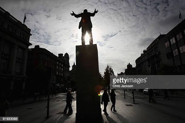 The sun shines through a statue of the Irish Union leader James Larkin on O'Connell Street on October 15 2009 in Dublin Ireland Dublin is Ireland's...