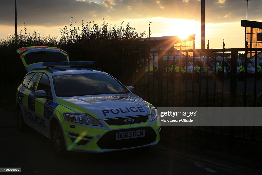 The sun shines through as a police car waits outside the stadium prior to the Vanarama Conference match between Chester and Wrexham at the Deva Stadium on September 22, 2014 in Chester, England.