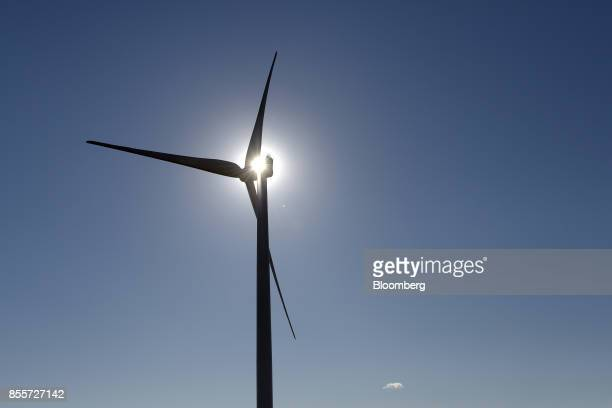 The sun shines through the blades of a wind turbine at the Hornsdale wind farm operated by Neoen SAS near Jamestown South Australia on Friday Sept 29...
