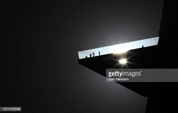 The sun shines through the glass floor of the Edge NYC as people stand on the outdoor skydeck 100 floors high at the top of 30 Hudson Yards on March...