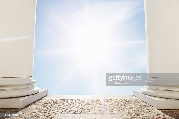 the sun shining between pillars. - heaven stock pictures, royalty-free photos & images