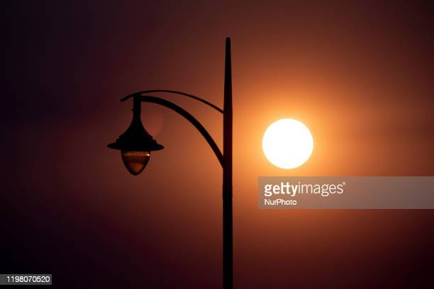 The sun shrouded by a haze of smoke is seen inChristchurch New Zealand on January 15 2020 A thick haze in the sky could be seen over Christchurch...