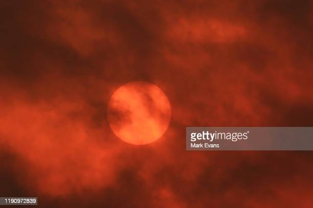 The sun turns red as a dust storm blows over the track during Sydney Racing at Rosehill Gardens on November 30 2019 in Sydney Australia