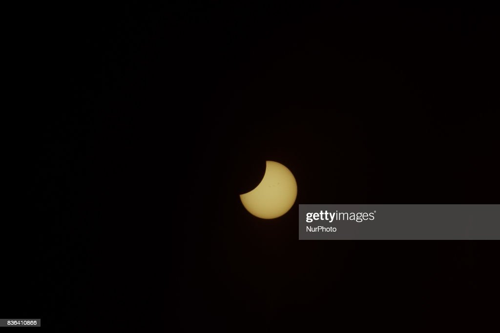 The sun was covered by the moon Partial Eclipse viewed briefly shown from the Mexico City on August 21, 2017 in Mexico City, Mexico