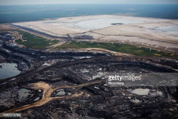 The Suncor Energy Inc Steepbank mine is seen in this aerial photograph taken above the Athabasca oil sands near Fort McMurray Alberta Canada on...