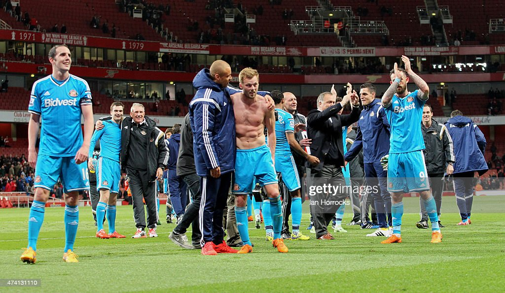 The Sunderland team and staff celebrate on the final whistle during the Barclays Premier League match between Arsenal and Sunderland at the Emirates Stadium on May 20, 2015 in London, England.