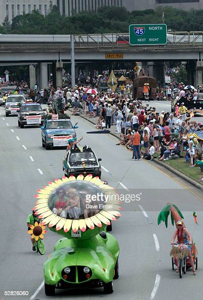 The Sunflower Car rolls out of downtown during the Everyone's Art Car Parade May 14 2005 in Houston Texas The parade includes around 280 cars and is...