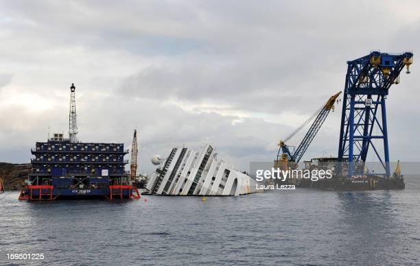 The sunken Costa Concordia remains in the water the day after the commemoration for the victims on January 14 2013 in Giglio Porto Italy It is now a...