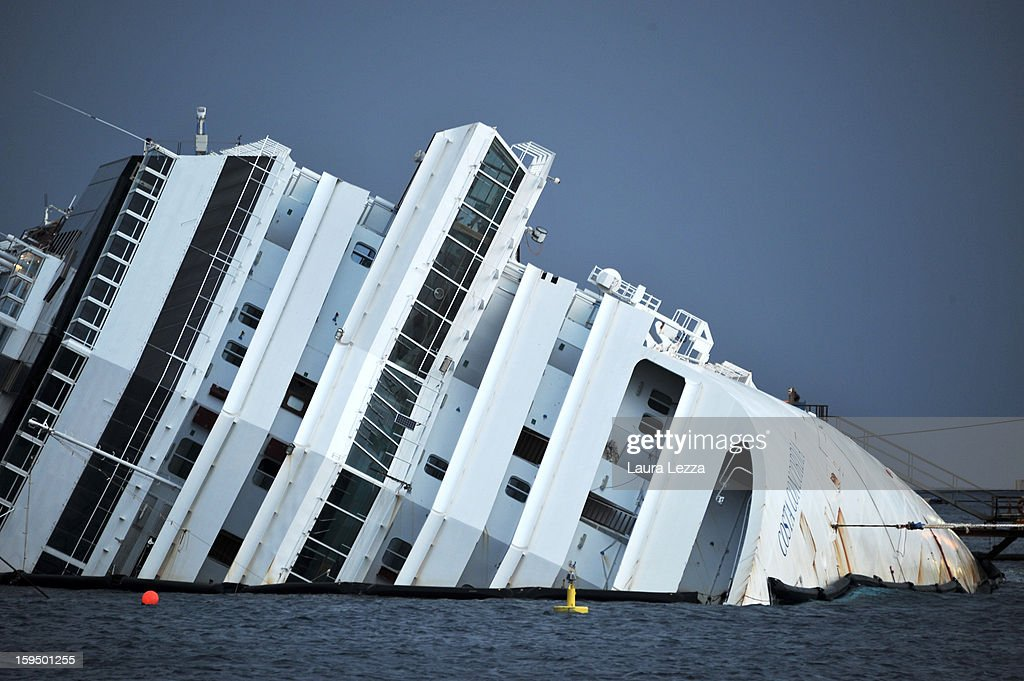 The sunken Costa Concordia remains in the water the day after the commemoration for the victims on January 14, 2013 in Giglio Porto, Italy. More than four thousand people were on board when the ship hit a rock off the Tuscan coast, killing 32 and leaving two people missing.