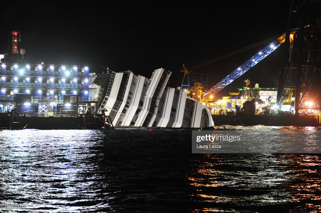 The sunken Costa Concordia remains in the water the day before the commemoration for the victims on January 12, 2013 in Giglio Porto, Italy. More than four thousand people were on board when the ship hit a rock off the Tuscan coast, killing 32 and leaving two people missing.