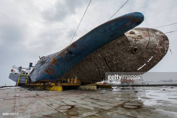 The sunken ferry Sewol on a semisubmersible transport vessel is seen during the salvage operation in waters off Jindo South Korea Salvage crews towed...