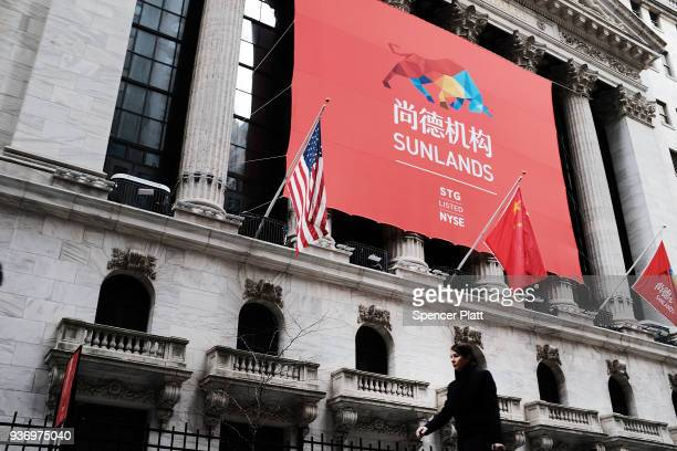 The Sunlands Online Education banner and the Chinese flag hang in front of the New York Stock Exchange during the Beijing-based firms IPO on March...