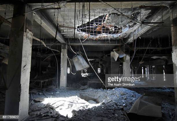 The sunlight comes through in the Mosul University Central Library as it is destroyed by repeated bombardment during the battle ahead of a month...