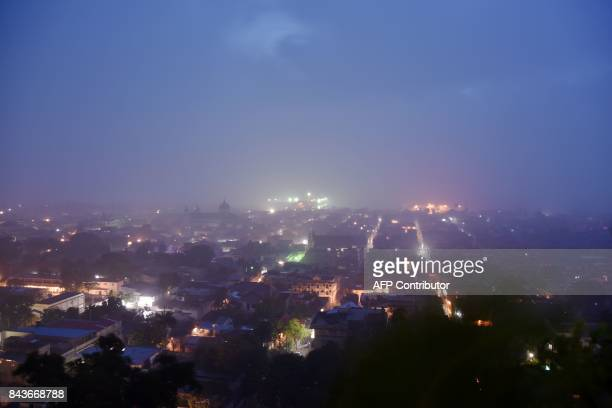 TOPSHOT The sunrise is seen through the rain in CapHaitien on September 7 240 km from PortauPrince as Hurricane Irma approaches Powerful Hurricane...
