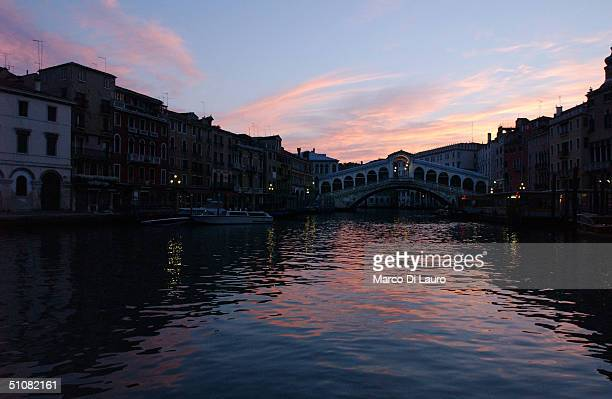 The sunrise lights an empty Rialto bridge in Canal Grande at the end of the celebration for the Festa del Redentore in Venice July 19 2004 This...